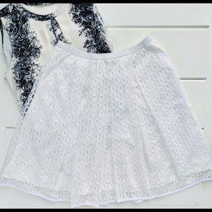 Maeve - pleated white lace overlay skirt